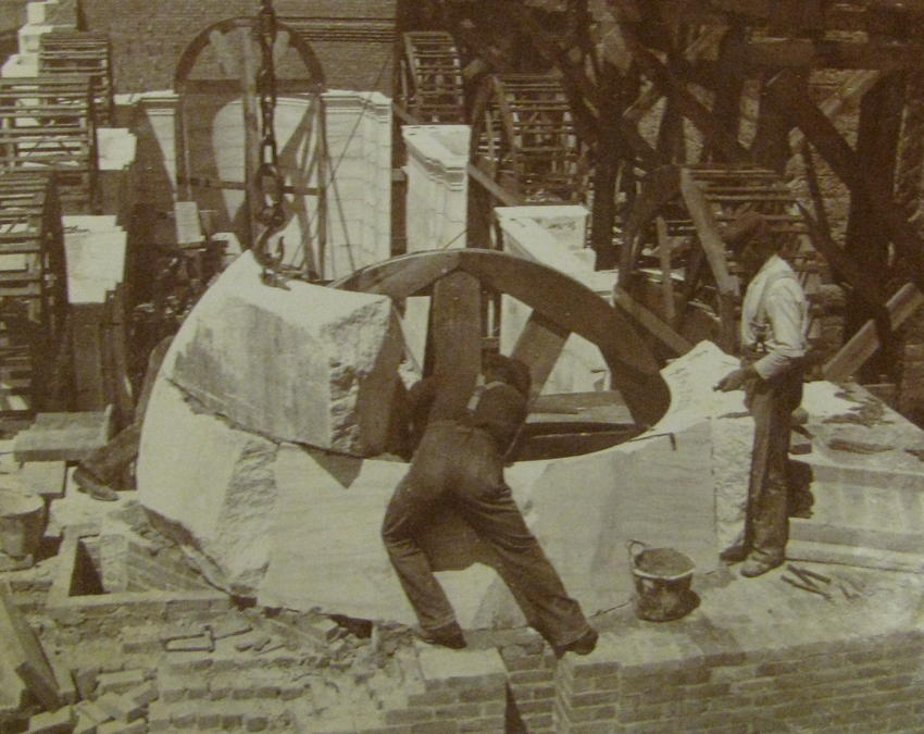 Workers setting rough stone in place, 1899-6-12